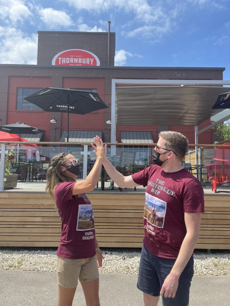 Thornbury Staff doing a high five on the patio